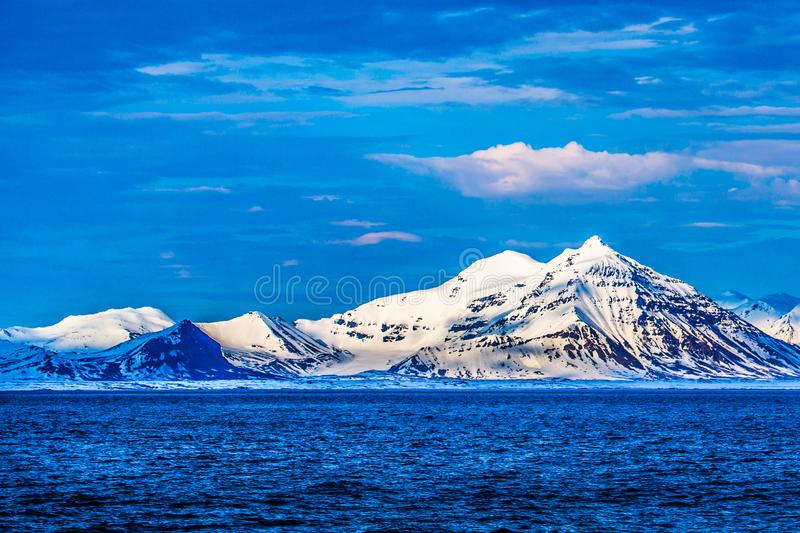Norway landscape ice nature of the glacier mountains of Spitsbergen Longyearbyen Svalbard arctic ocean winter polar day sunset sky royalty free stock image