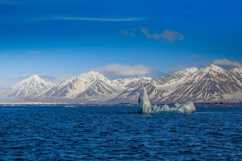 Norway landscape ice nature of the glacier mountains of Spitsbergen Longyearbyen Svalbard arctic ocean winter polar day sunset sky royalty free stock images