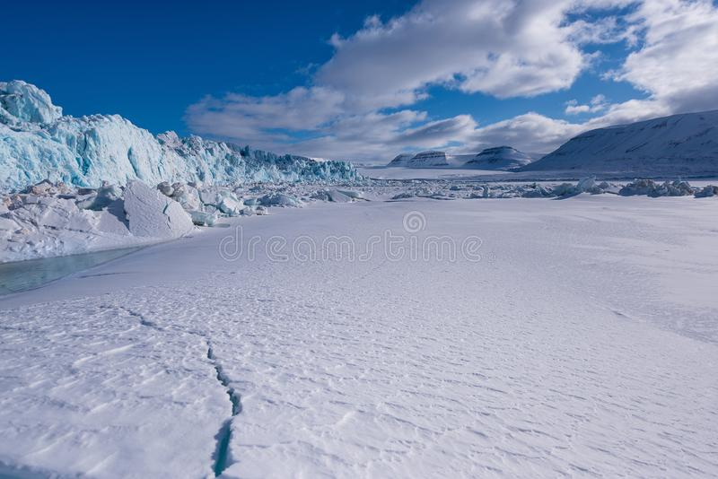 Landscape nature of the glacier mountain of Spitsbergen Longyearbyen Svalbard arctic winter polar sunshine day stock photo