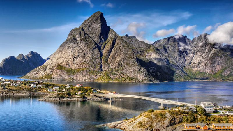 Norway Lofoten Fjord, Arctic Mountains Landscape. Beautiful Norwegian fjord and fishing village. Arctic mountains landscape, Lofoten. Norway royalty free stock images