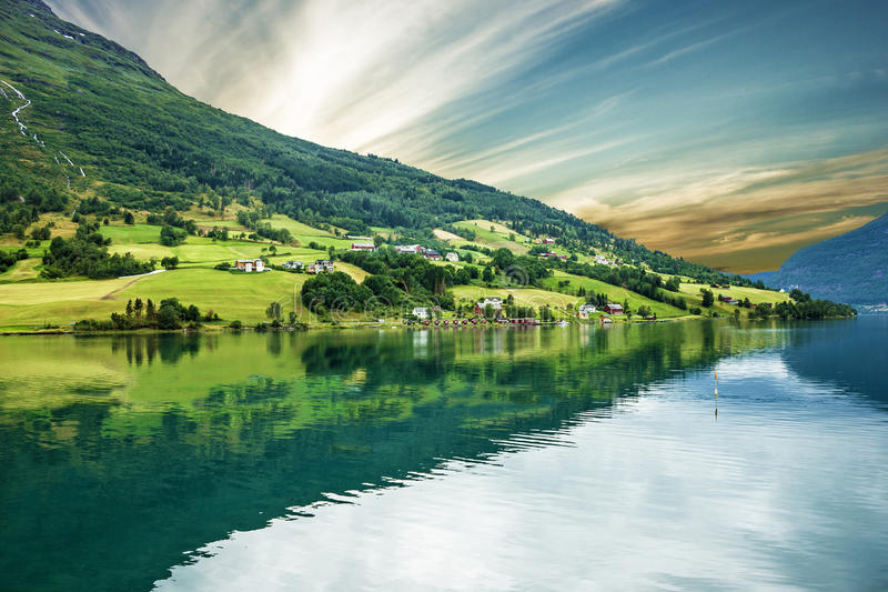 Norway, Olden, green hills seaside. Norwegian fjord in summer. stock image