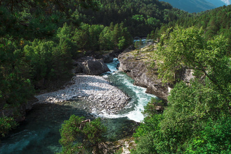 Norway , the river between the mountains. Green stock photography