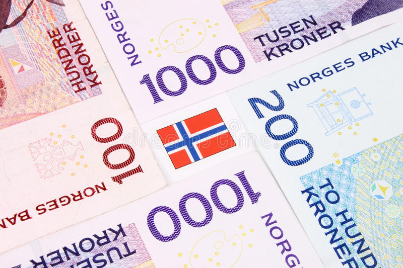 Norwegian Bank Notes & Flag. A closeup of Norwegain currency bank notes royalty free stock photo