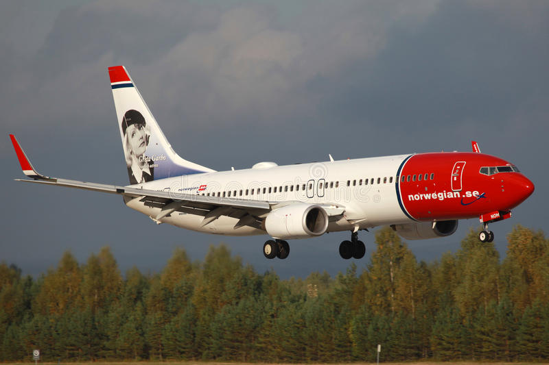 Norwegian Boeing 737-800. Oslo, Norway - September 16, 2012: A Norwegian Boeing 737-800 with the registration LN-NOM and Greta Garbo on the tail approaches Oslo stock photo