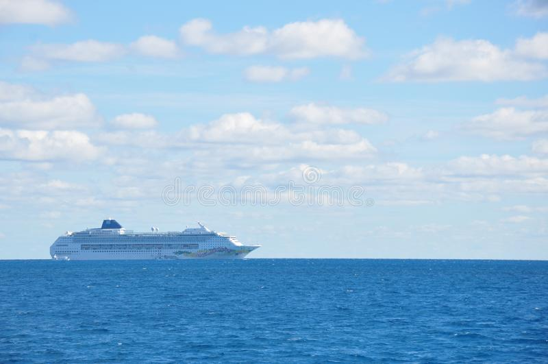 Norwegian Cruise Line ship at sea sailing. Norwegian Cruise Line ship far at sea sailing the ocean royalty free stock photography
