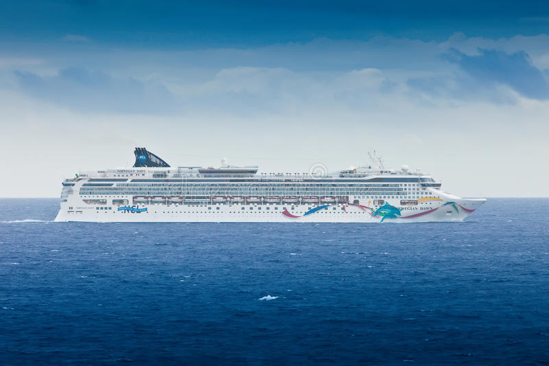 Norwegian Cruise Lines. Miami, FL - January 22, 2011: NCL's cruise ship, the Norwegian Dawn, heads back to port in Miami, Florida. Recently, this ship underwent stock photos