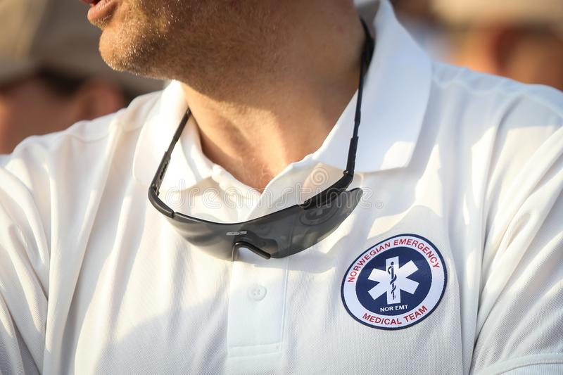 Norwegian emergency medical team symbol. On the shirt of a man royalty free stock photo