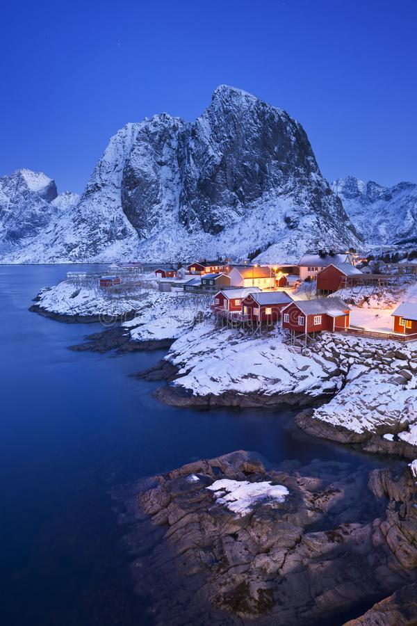 Norwegian fisherman`s cabins on the Lofoten in winter. Traditional Norwegian fisherman`s cabins, rorbuer, on the island of Hamnøy, Reine on the Lofoten in royalty free stock images
