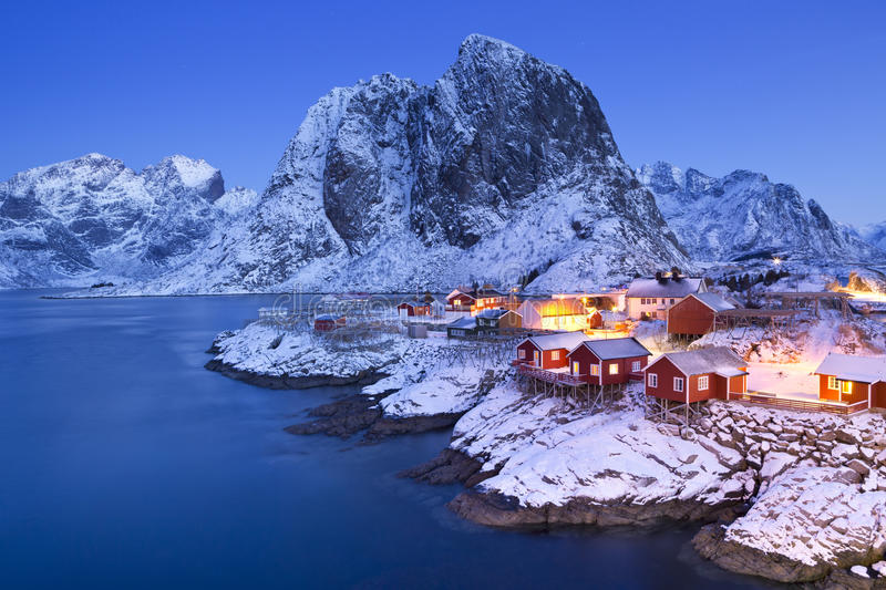 Norwegian fisherman's cabins on the Lofoten in winter. Traditional Norwegian fisherman's cabins, rorbuer, on the island of Hamnøy, Reine on the Lofoten in