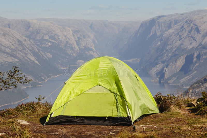 Norwegian fjord landscape with camping tent. Norway adventure. Outdoor royalty free stock images