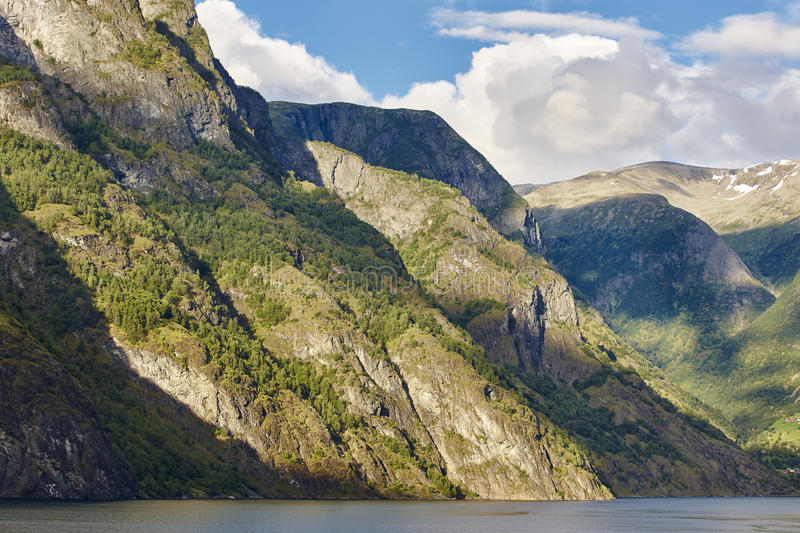 Norwegian fjord landscape. Mountains, water and forest. Norway s. Cenic. Horizontal royalty free stock images