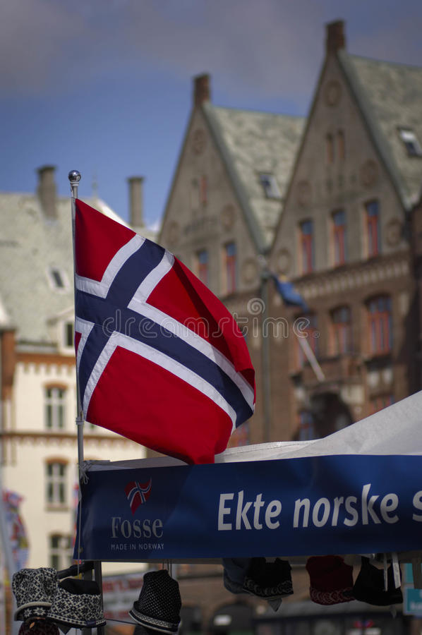 Norwegian flag with Bryggen behind royalty free stock photography