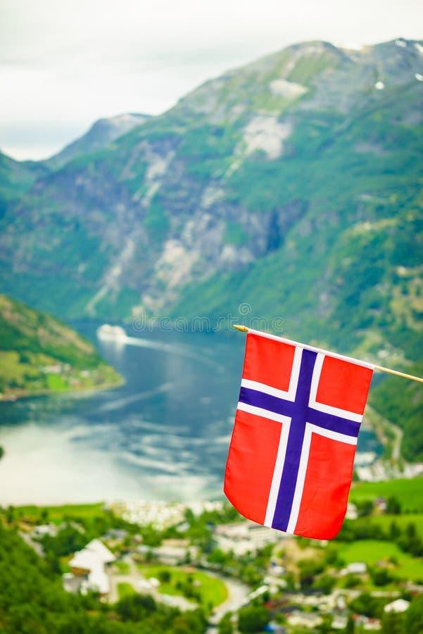 Norwegian flag and Geiranger fjord landscape stock images