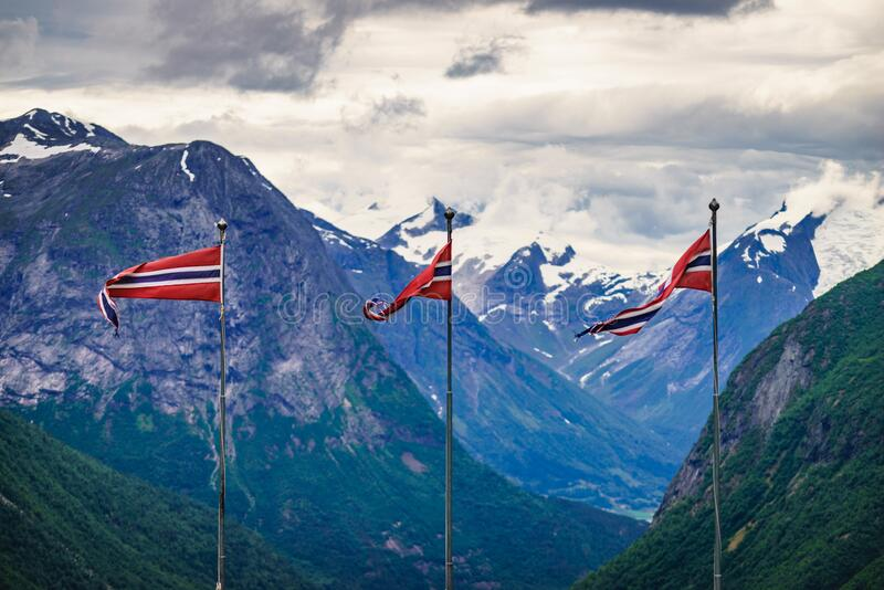 Norwegian flags and mountains landscape royalty free stock image
