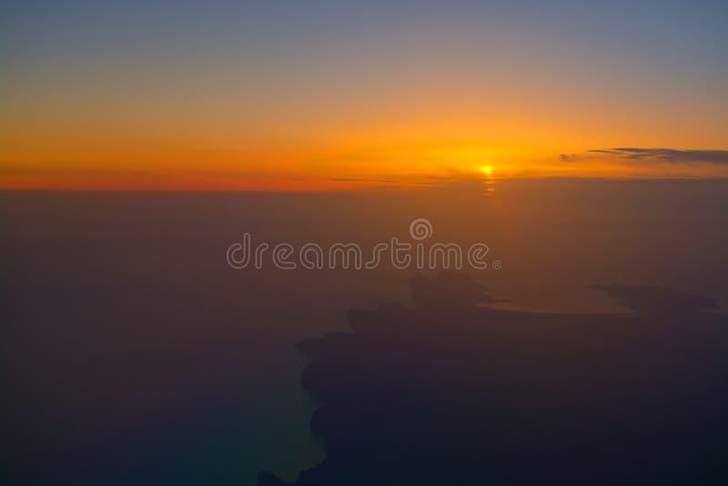 Norwegian flight image at sunrise in the ocean beyond Menorca. Flight image at sunrise in the ocean beyond Menorca in early morning in April in Mallorca, Spain stock images