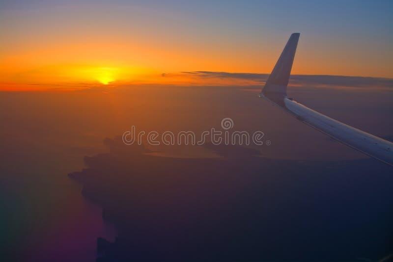 Norwegian flight image at sunrise in the ocean beyond Menorca. MALLORCA, SPAIN - APRIL 27, 2018: Norwegian flight image at sunrise in the ocean beyond Menorca in stock photo