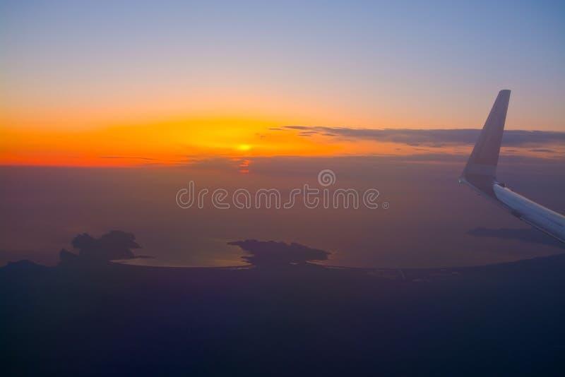 Norwegian flight image at sunrise in the ocean beyond Menorca. MALLORCA, SPAIN - APRIL 27, 2018: Norwegian flight image at sunrise in the ocean beyond Menorca in royalty free stock image