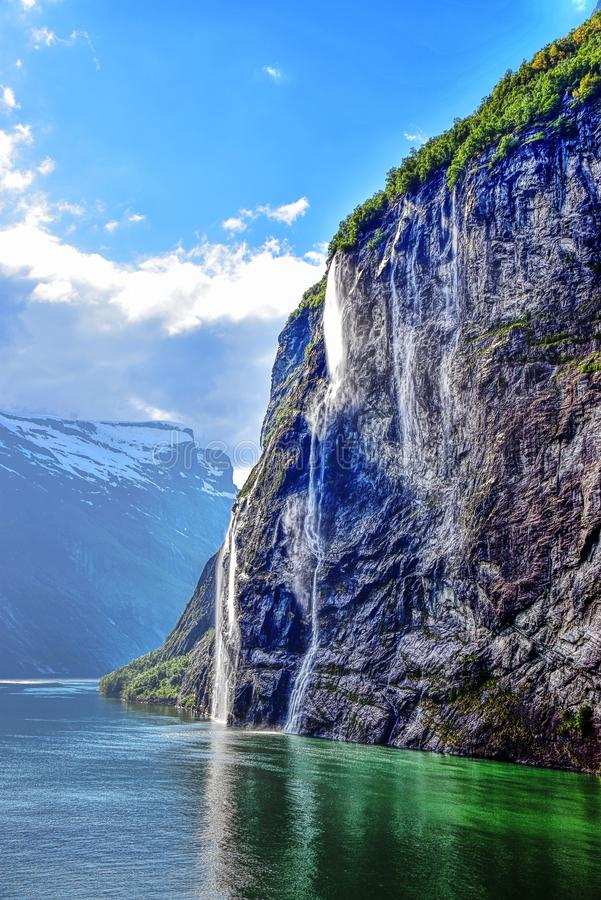 Geiranger Fjord with Waterfall in beautiful scenery stock images