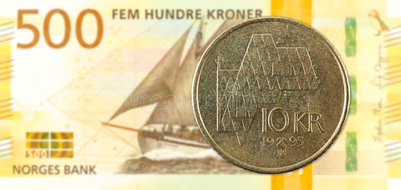 10 norwegian krone coin against 500 new norwegian krone banknote royalty free stock photo