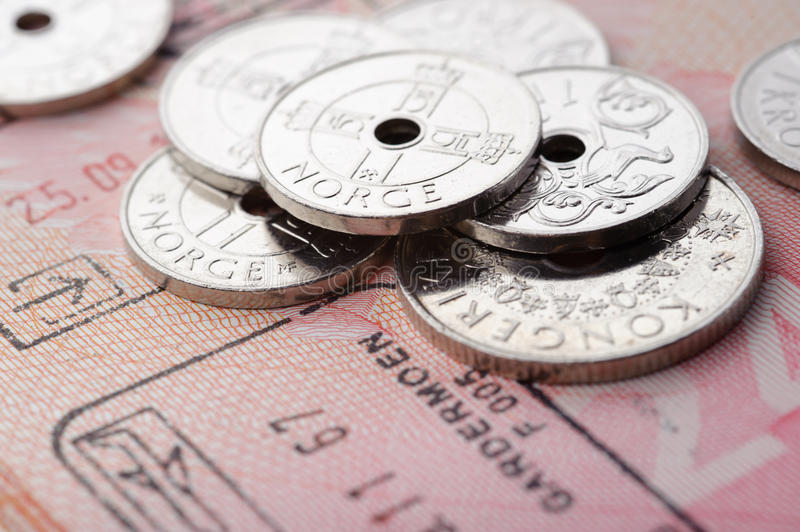 Norwegian krone coins and passport page royalty free stock image