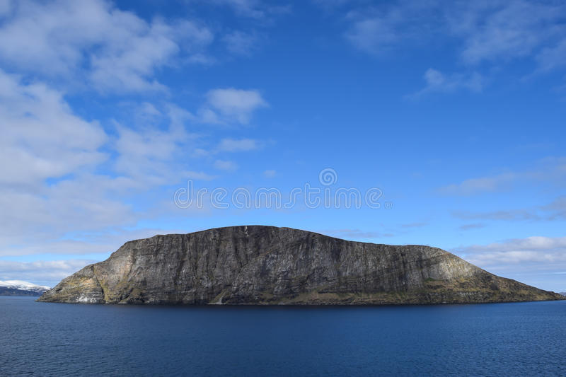 Norwegian mountains seen from the sea. Above the Arctic Circle. stock photography