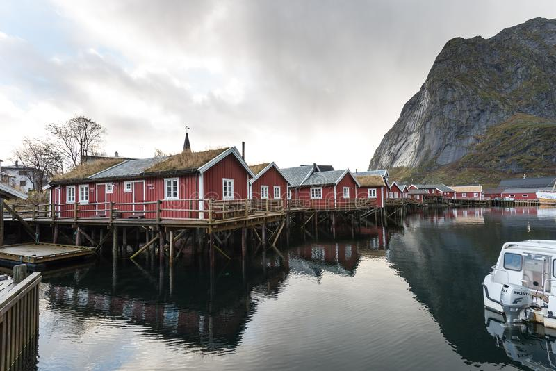 Norwegian old city Reine with reflections in water and cloudy sk royalty free stock photos
