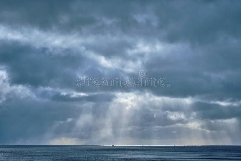 Norwegian sea in winter with sun rays stock photos