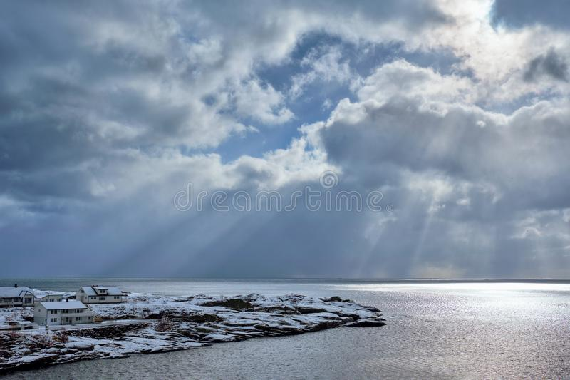 Norwegian sea in winter with sun rays stock images