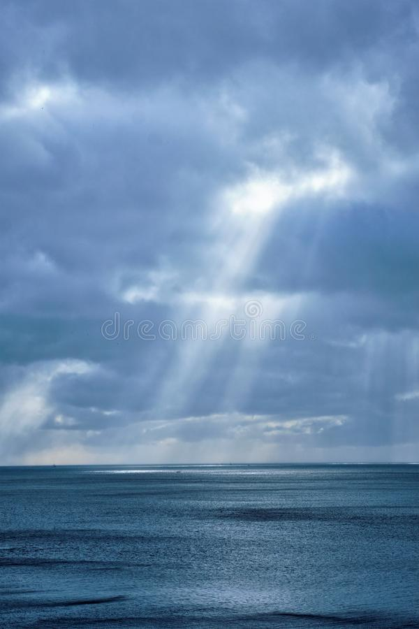 Norwegian sea in winter with sun rays stock photography