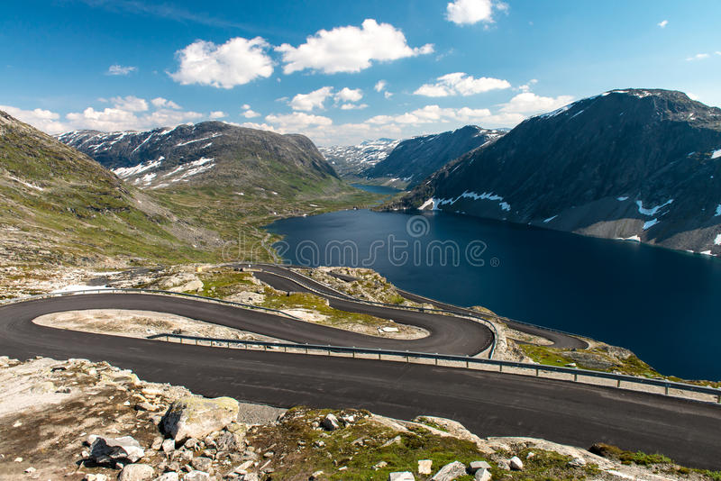 Norwegian serpentine road. The road is so narrow that disperse colliding buses almost impossible stock images