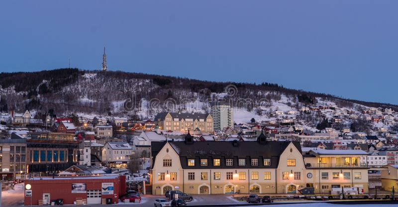 Norwegian town and mountains stock images