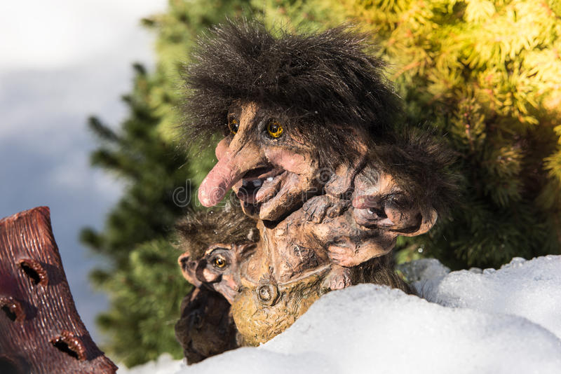 Norwegian Trolls. Family of Scandinavian Trolls in the snow royalty free stock photography