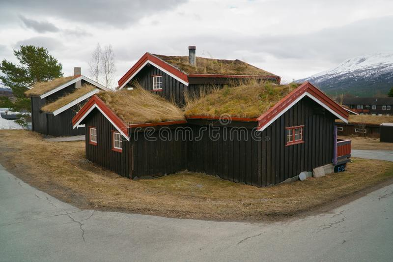 The Norwegian typical grass roof country house, classic wooden cottage in Norway, countryside. stock photography