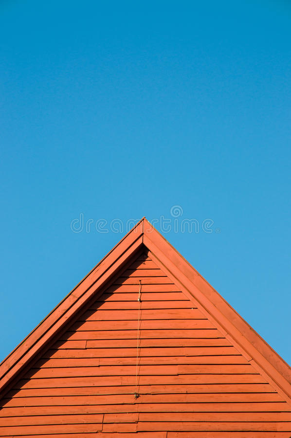 Norwegian wood house against a blue sky. Norway royalty free stock photos