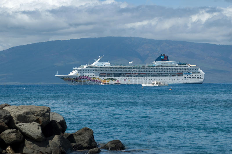 Norweigen cruise ship in a tropical port royalty free stock photography