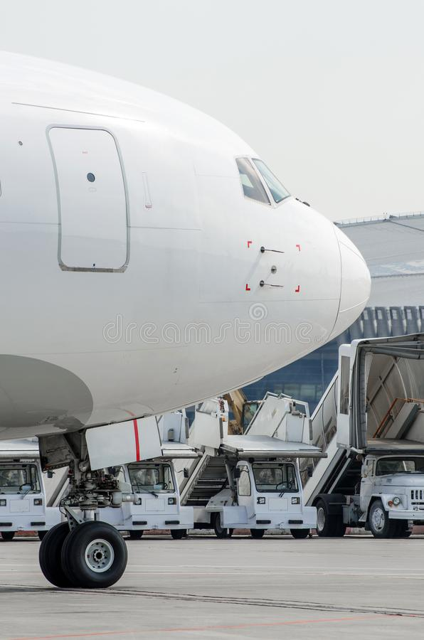 Free Nose And Cockpit, On The Front Rack Of The Chassis-close-up, Against The Background Of The Ladder And The Airport Machine. Royalty Free Stock Image - 109327916
