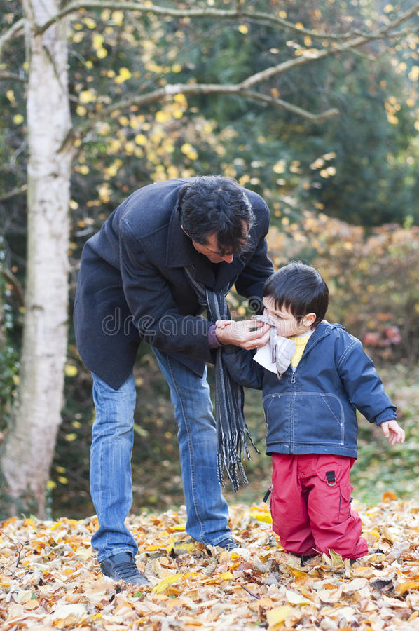 Download Father Wiping His Son Nose Royalty Free Stock Photos - Image: 22055268