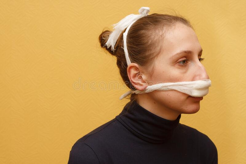 Nose injury medical first aid bandage royalty free stock photo
