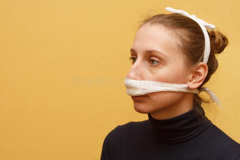 Nose injury medical first aid bandage royalty free stock image