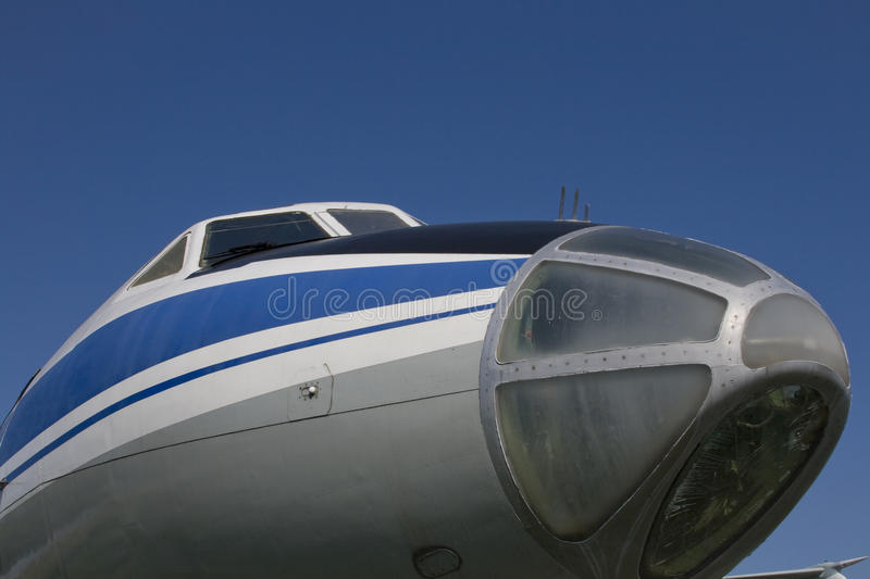 Nose of old jet plane. Cockpit of old jet plane TU-134A on blue sky background stock images
