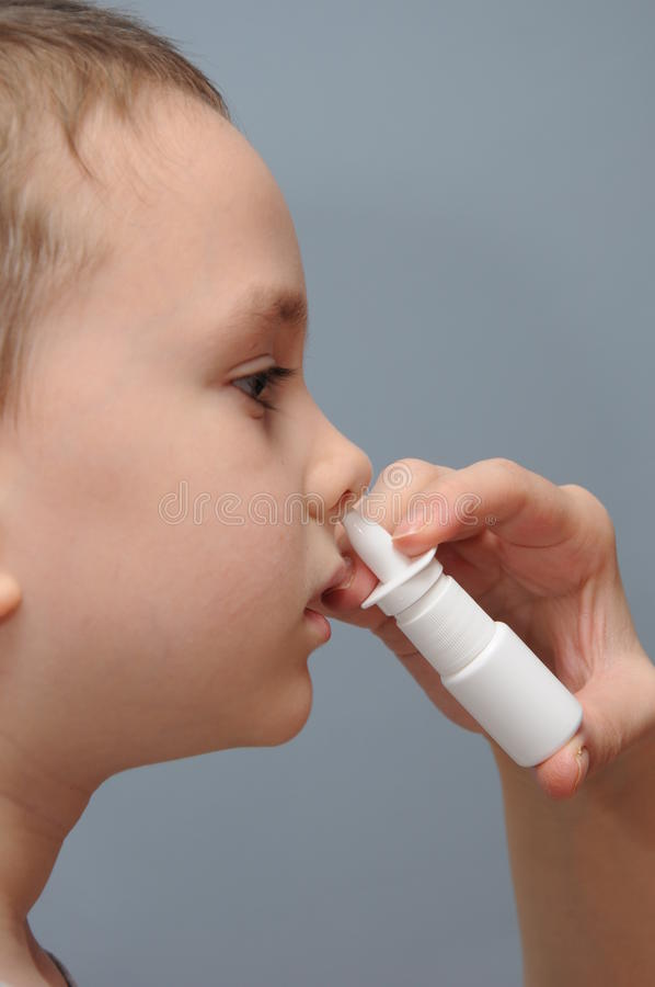 Nose spray for children stock photography