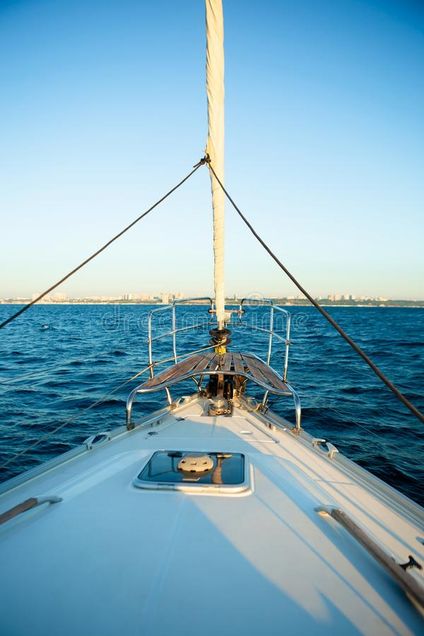 Nose of yacht sailing in the sea stock photography