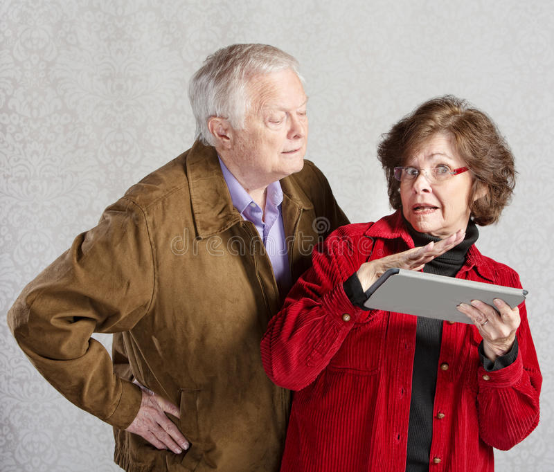 Nosey Man and Lady with Tablet royalty free stock photo