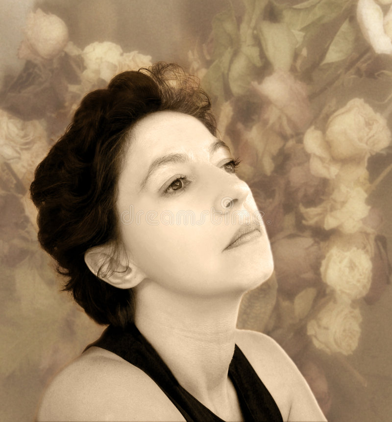 Nostalgia. Sepia woman with dried flowers on the background stock images