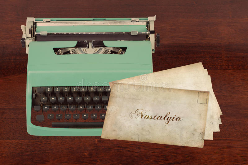 Nostalgia. Conceptual Image of Old Letters with Nostalgia Print and a Typewriter on a Table stock image