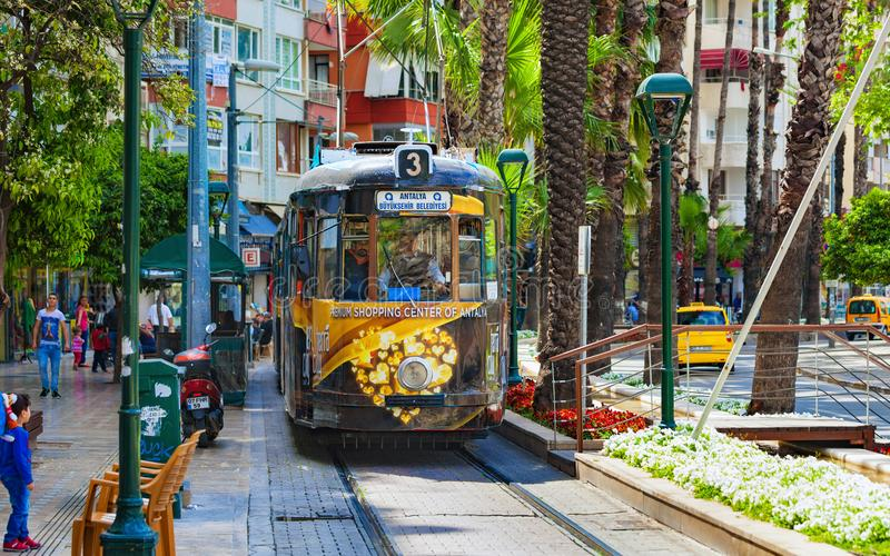 Nostalgia tram runs through city center in Antalya, Turkey stock images