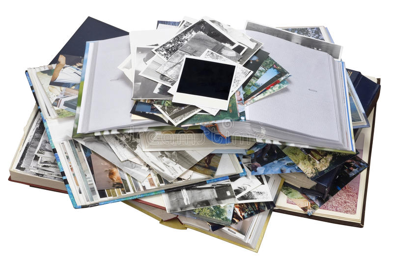 Nostalgia by youth isolated. Nostalgia by youth - old family photo albums and photos heap. Isolated with patch stock photography