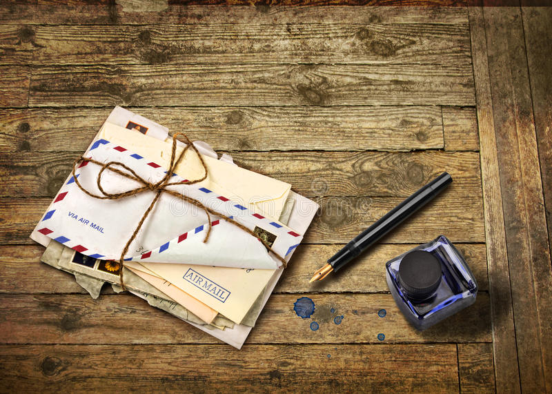 Nostalgic airmail letters. With ink bottle and fountain pen royalty free stock photo