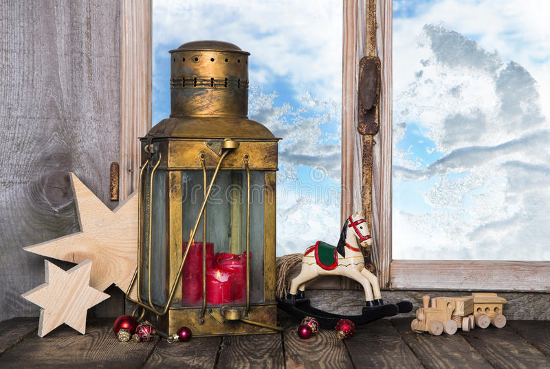 Nostalgic old christmas decoration with old toys and a old lantern with candles. stock images