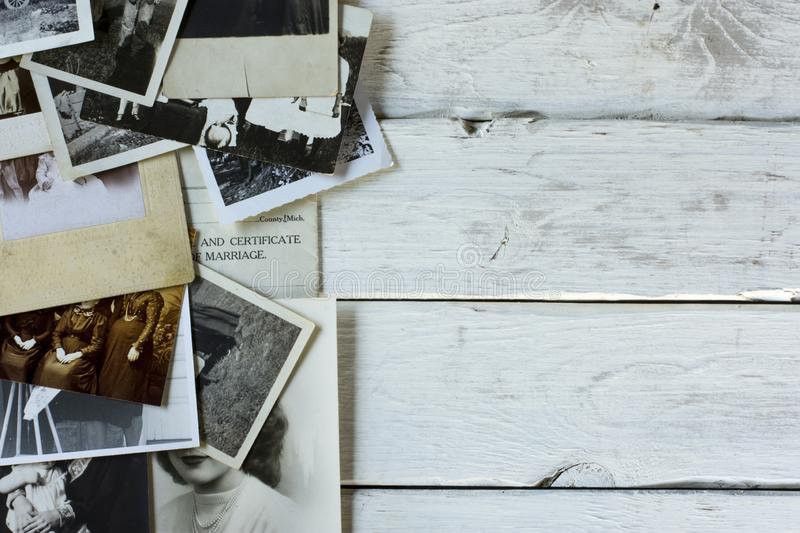 Nostalgic Old Photographs and Documents. Genealogy family history theme with old family photos and documents royalty free stock photos